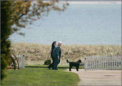Sen. Edward Kennedy, D-Mass., and his wife, Victoria Reggie Kennedy, go for a walk at the family's compound in Cape Cod, Mass., on Wednesday after the senator's release from Massachusetts General Hospital. Kennedy has been diagnosed with a malignant brain tumor.