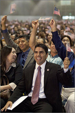 "Eddie ""Piolin"" Sotelo, host of Univision Radio's nationally syndicated morning show, expresses joy after taking the citizenship oath during naturalization ceremonies at the Los Angeles Convention Center."