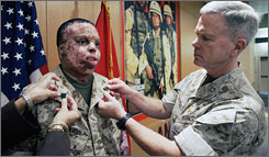 In this May 21, 2007 file photo, Marine Sgt. Merlin German, left, poses for photos with Lt. Gen. James F. Amos during German's promotion ceremony at Brooke Army Medical Center in San Antonio.