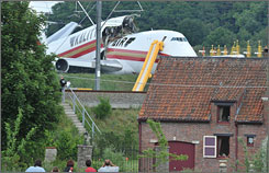 The cargo plane broke up and slid, stopping less than 550 yards from people's homes.
