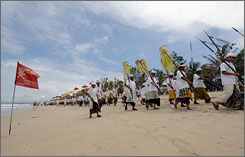 Balinese people hold the Melasti ceremony, a purification festival.