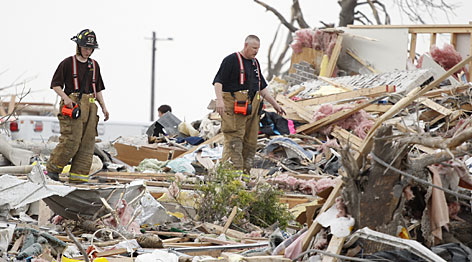 Firefighters look for survivors Sunday after a tornado hit Parkersburg, Iowa