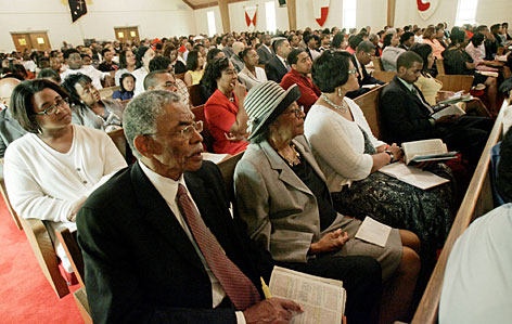 New Hope Missionary Baptist Church Deacon Jesse McGee, foreground, and his wife Warine, second from foreground, attend services at the Jackson, Miss., church.