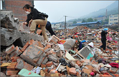 Survivors search through the rubble where their home once stood in Hanwang.