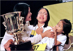 Wendy Guey, center, won the National Spelling Bee in 1996. Guey, now ...