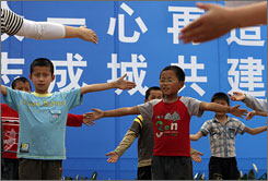 Children affected by the earthquake participate in a volunteer run activity at a refugee housing camp May 26 in Dujiangyan, Sichuan province, China.
