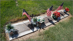 From left, the graves of Nathan Hubbard, Jared Hubbard and Jeremiah Baro. Tony Butterfiled, who asked to be buried near Jeremiah and Jared, rests 10 feet away.