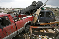 The storm that battered Parkersburg, Iowa, killed six people and destroyed dozens of homes.
