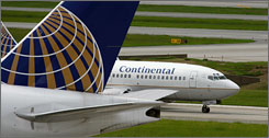 A Continental Airlines pilot has said he saw what looked like a model rocket shoot past his cockpit window shortly after taking off from George Bush Intercontinental Airport in Houston on Monday, according to federal officials. Here, Continental planes are seen on the runway of the Houston airport in July 2007.