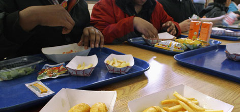 Students eat at Washington Middle School in Springfield, Ill. Illinois legislators have been considering a ban on trans fats, blamed for contributing to national childhood obesity rates, in foods served in school cafeterias and vending machines.