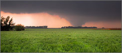 A giant wedge tornado travels across the horizon May 23 three miles south of Quinter, Kan.