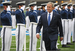 President Bush told men and women graduating from the U.S. Air Force Academy in Colorado Springs, Colo., on Wednesday that it has been necessary to help Iraq and Afghanistan. Here, Bush makes his way onto the field of Falcon Stadium to take part in the academy graduation and commissioning ceremony.