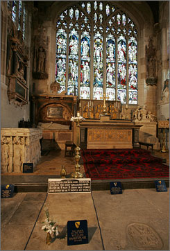 The grave of playwright William Shakespeare, front with flower, near the altar inside Holy Trinity Anglican Church in the bard's hometown of Stratford upon Avon, England.