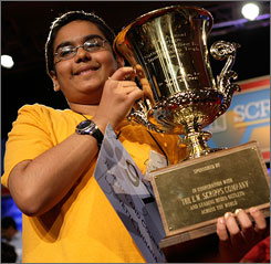 Sameer Mishra of West Lafayette, Indiana, holds up his winning trophy in the 2008 Scripps National Spelling Bee May 30 in Washington, DC.