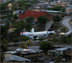 A jetliner overshot a runway and raced onto a busy street in the Honduran capital.