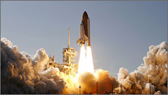 The space shuttle Discovery lifts off from launch pad 39A at the Kennedy Space Center in Cape Canaveral, Florida.