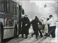 Transit insiders expect an increase in passengers, like these negotiating the snow to board a New York City bus, as gas hovers near $4 a gallon.