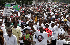 Thousands of St. Louis residents take to the streets during a unity march against violence June 1.