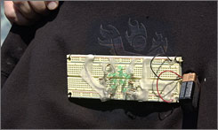 MIT sophomore Star Simpson wore this computer circuit board on the front of a sweatshirt and was arrested at gunpoint at Logan International Airport in Boston.