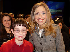 Sixth-grader Jack Greenberg, 11, who is covering the election for Scholastic News, poses with Chelsea Clinton in West Haven, Conn.