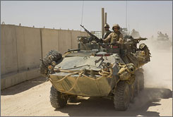 Marines from the Light Armored Reconnaissance Battalion leave Camp Korean Village, Iraq, on Sept. 10, 2007. The Marines operate in Anbar province.