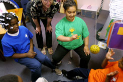 Third-graders, from left, Javae Greer, Destiny Washington and Jamie Belton use a Marsden ball to learn how to follow the trajectory of moving objects with visual therapist Cheryl Steffenella at Gordon Parks Elementary School in Kansas City, Mo.