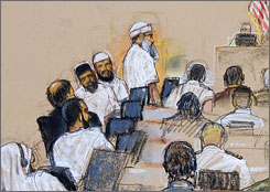 Terrorism suspects attend a court hearing Thursday at the U.S. Naval Base in Guantanamo Bay, Cuba. The alleged al-Qaeda mastermind behind the 9/11 attacks, Khalid Sheikh Mohammed, standing, said he would welcome the death penalty.