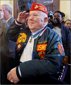 Medal of Honor recipient Jack Lucas, 80, salutes Sen. Hillary Clinton, after she acknowledged him at a campaign stop in Hattiesburg, Miss. Lucas, the youngest Marine to be awarded the Medal of Honor following action in Iwo Jima, died at age 80 today.