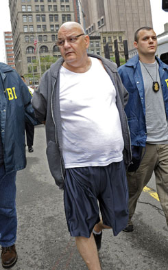 "Reputed acting boss of the Colombo crime family Thomas ""Tommy Shots"" Gioeli is led to his arraignment today in New York. Eight other suspected mobsters were nabbed in the takedown."