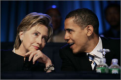 Sen. Hillary Clinton speaks with Sen. Barack Obama, right, during the annual NAACP convention in Washington, in July 2006. After a divisive race marred by racism and sexism, Clinton plans to start her new role as an Obama booster this weekend.