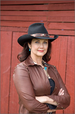 Actress Lynda Carter says she didn't do anything extraordinary when she flagged down some fishermen after spotting the body of a 47-year-old woman floating in the Potomac River in the Washington, D.C., area this past week. Here, Carter is seen on the set of the 2005 movie 'The Dukes of Hazzard.'