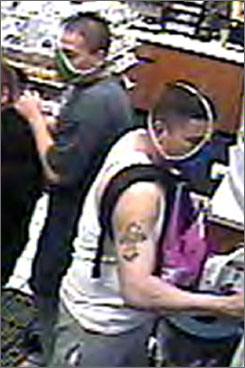 The so-called 'thong bandits,' robbery suspects who police say wore thongs to disguise themselves, are now in police custody. Here, they are captured on video inside a convenience store in Arvada, Colo., on May 16.