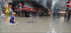 Hong Kong has been left with flooded streets and landslides after being hit by torrential rain on Saturday.