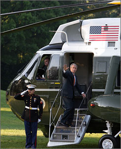 President Bush waves as he departs the White House grounds for his European trip Monday morning.