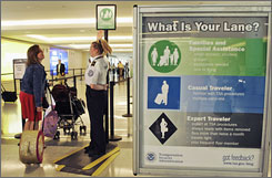 TSA agent Kimberly Hughes explains the system last month at Chicago's Midway International Airport.