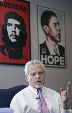 Lourain County Common Pleas Judge James Burge speaks in his office in Lorain, Ohio as posters of Che Guevara and Barack Obama hang on his wall.