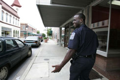 Newberry Police Patrolman Jonathan Taylor walks his beat in Newberry, S.C., instead of driving his patrol car as a way to cut the use of gas.