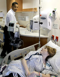 Sen. Barack Obama talks with Shelby Davis, 17, at Barnes-Jewish Hospital in St. Louis. The Democratic presidential candidate has shied away from large rallies since winning his party's nomination.