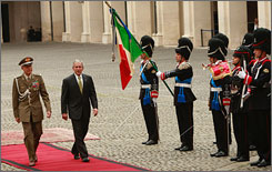 President Bush, center is escorted by Gen. Rolando Mosca Moschini, left, as they walk past Guardia D'Onore during his arrival at the Quirinale Palace in Rome on Thursday. While in Italy, Bush plans to ask for help with Afghanistan assistance.