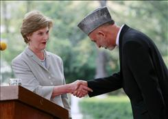U. S. first lady Laura Bush is acting as one of Afghanistan's chief fundraisers. Afghanistan President Hamid Karzai seeks $50 billion in aid for his country.