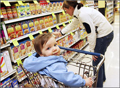 """Christina Beahm shops for organic breakfast products with her 10-month-old son, Carson, in Lake Oswego, Ore., last April. """"I'm trying to get [my kids] eating healthy from the start,"""" she said."""