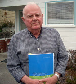 Retired Navy Lt. Cmdr. Jack Alderson stands outside his California home holding a recent report on health effects from top-secret Pentagon chemical tests.