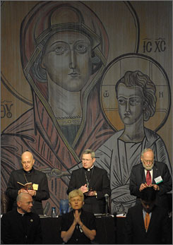 Archbishop of Chicago Cardinal Francis George, left, and Monsignor David Malloy of Milwaukee lead the opening prayer during the general meeting of the U.S. Conference of Catholic Bishops in Orlando, Fla., Thursday.