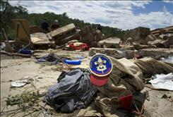 A tornado that struck Wednesday night left four Boy Scouts  killed and 48 people injured.