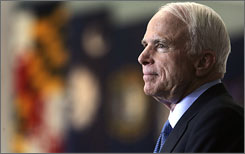 John McCain listens to a question being asked by a supporter as he hosts a town hall meeting at the National Constitution Center in Philadelphia.