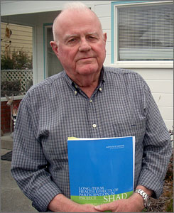 Retired Navy Lt. Cmdr. Jack Alderson, in front of his Ferndale, Calif. home, holds a recent report on health effects from top-secret Pentagon chemicals tests he participated in during the 1960s.