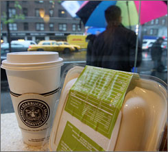 Sandwich packaging shows its nutritional value at a New York Starbucks. New York has become the first U.S. city to require restaurant chains to display calorie content on menus and packaging.