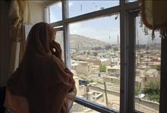 An Afghan prostitute talks on her phone in her Madame's house in Kabul, Afghanistan. A University of Manitoba report last September estimated about 900 female sex workers live in Kabul.