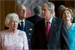 Britain's Queen Elizabeth II, left, and Prince Philip give President Bush and first lady Laura a tour of St. George's Hall on Sunday.