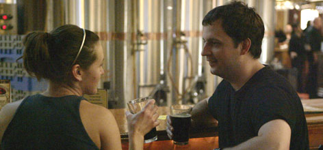 Jenny Kirkpatrick, left, and Tim Eckert sample some of the beer made and served at the Church Brew Works in Pittsburgh June 6.